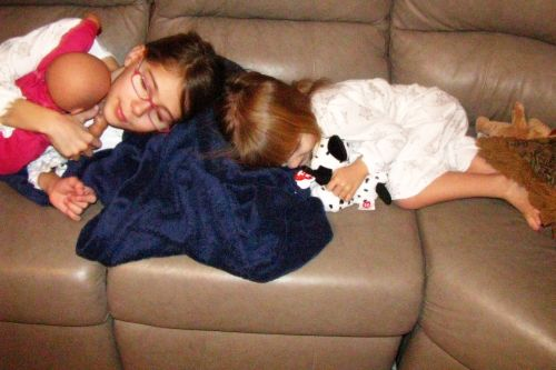 girls-sleeping-on-couch