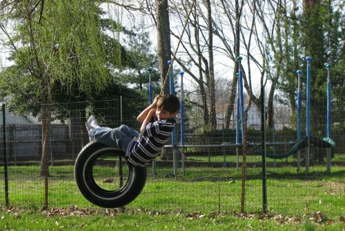 brian-on-tire-swing
