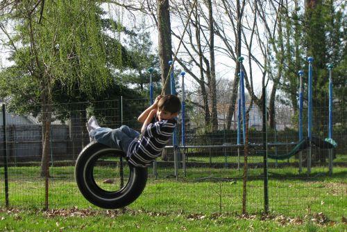 brian-on-tire-swing