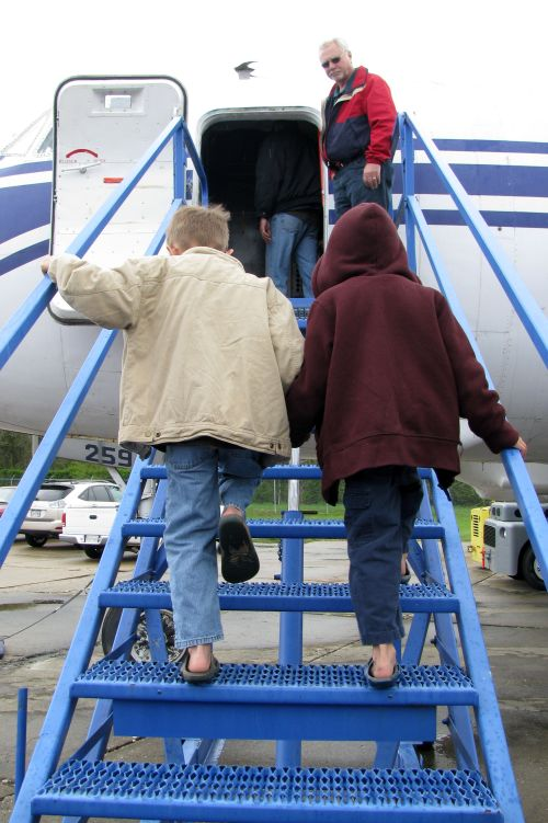 martins-boys-boarding-plane