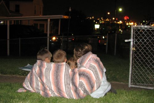 four kids watching fireworks