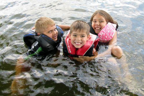 three swimming