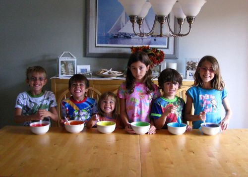 kids making rainbow cake