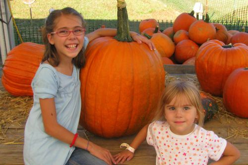 girls at pumpkins