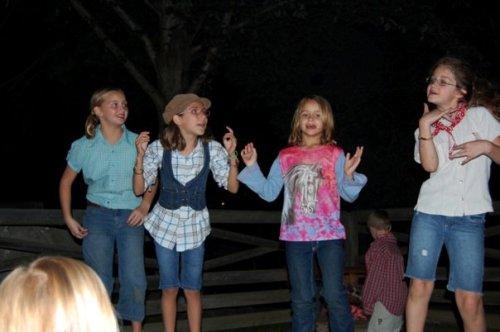 girls singing and dancing